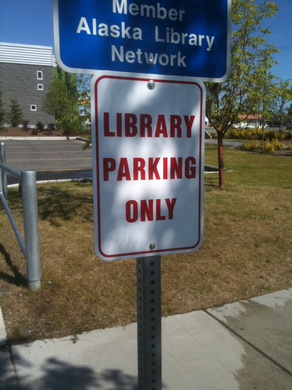 "A sign says ""Library Parking Only"""
